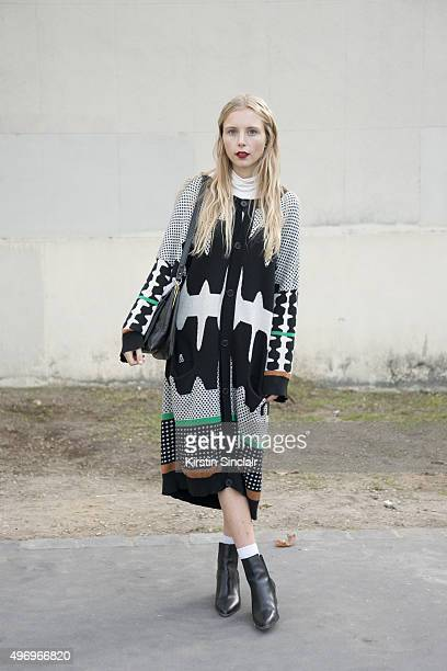 Fashion Blogger Marie My wears a Henrik Vibskov coat Zara shoes and a vintage bag on day 6 during Paris Fashion Week Spring/Summer 2016/17 on October...