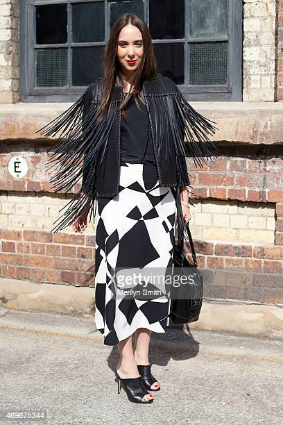 Fashion Blogger Marina Degiovanni wears a Malene Birger jacket and skirt Toni Bianco shoes and a Longchamp bag at MercedesBenz Fashion Week Australia...