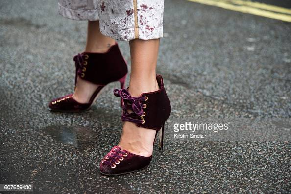 Fashion Blogger Marta Carriedo is wearing shoes by Jimmy Choo and trousers by Pull Bear day 1 of London Womens Fashion Week Spring/Summer 2016 on...