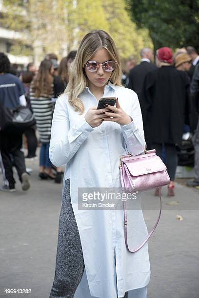 Fashion Blogger Martina Ritter wears a Zara top Dolce and Gabbana bag Sandro trousers and Dior sunglasses on day 6 during Paris Fashion Week...