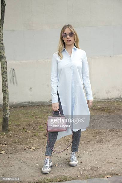 Fashion Blogger Martina Ritter wears a Zara top Prada shoes Dolce and Gabbana bag Sandro trousers and Dior sunglasses on day 6 during Paris Fashion...