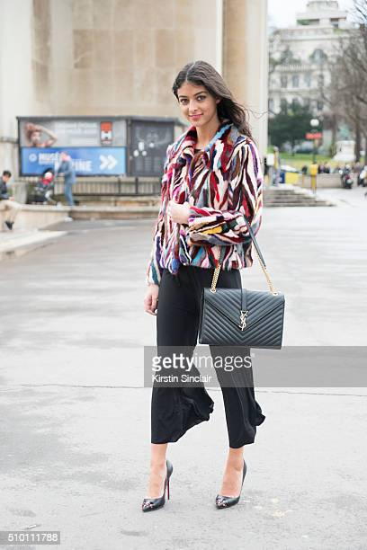 Fashion blogger Melanie Darmon wears a vintage jacket Yves Saint Laurent bag Balenciaga culottes and Louis Vuitton shoes on day 4 of Paris Haute...