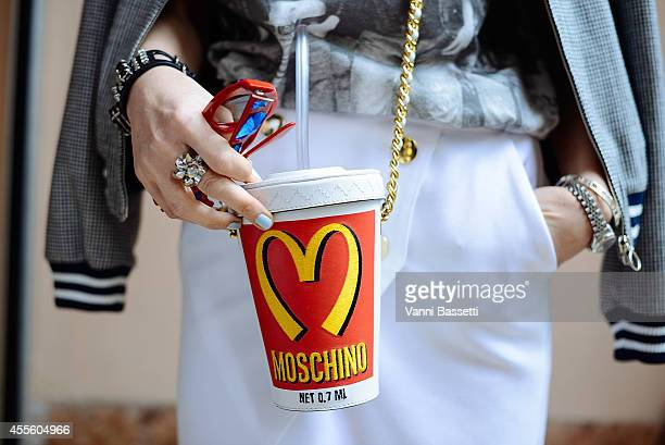 Fashion blogger Melissa Cabrini poses wearing a Valentino jacket Zara shirt and skirt Nike socks Prada shoes Moschino bag and Tiffany and Prada...