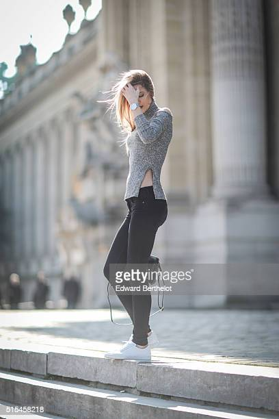 Fashion Blogger Meryl Denis is wearing Abercrombie black jeans a Boohoo top Agnes B shoes and an Agnes B bag during a street style session on March...