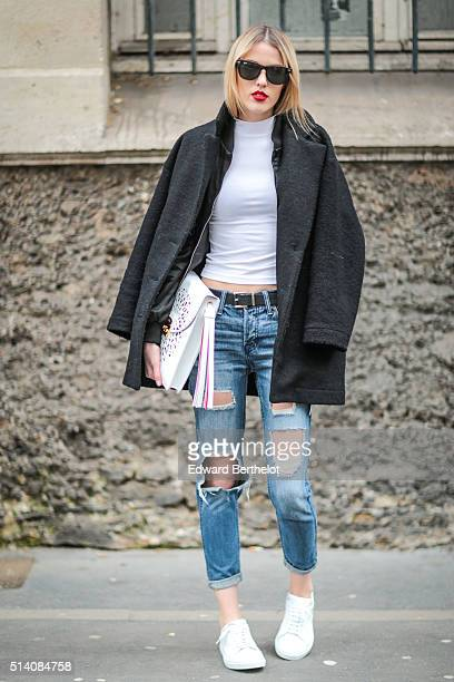 Fashion blogger Meryl Denis is wearing an American Apparel coat an American Apparel top Hollister jeans Agnes B shoes and a Furla bag before the John...