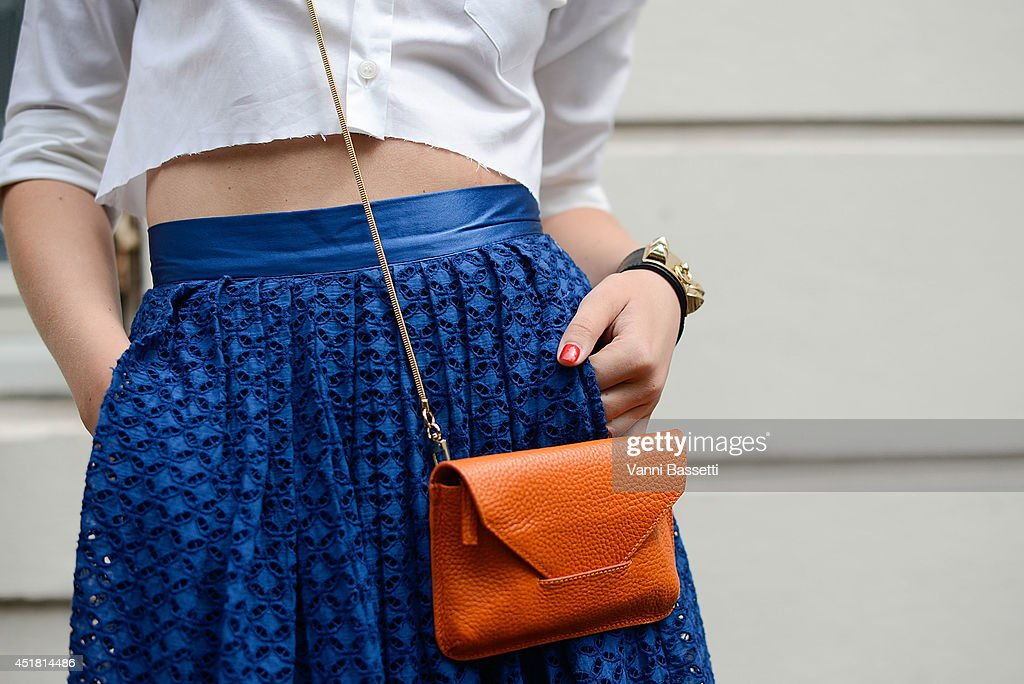 Fashion Blogger Mia Stoelen poses wearing a Filippa K shirt and bag HM skirt and Hermes bracelet before Dior show on July 7 2014 in Paris France