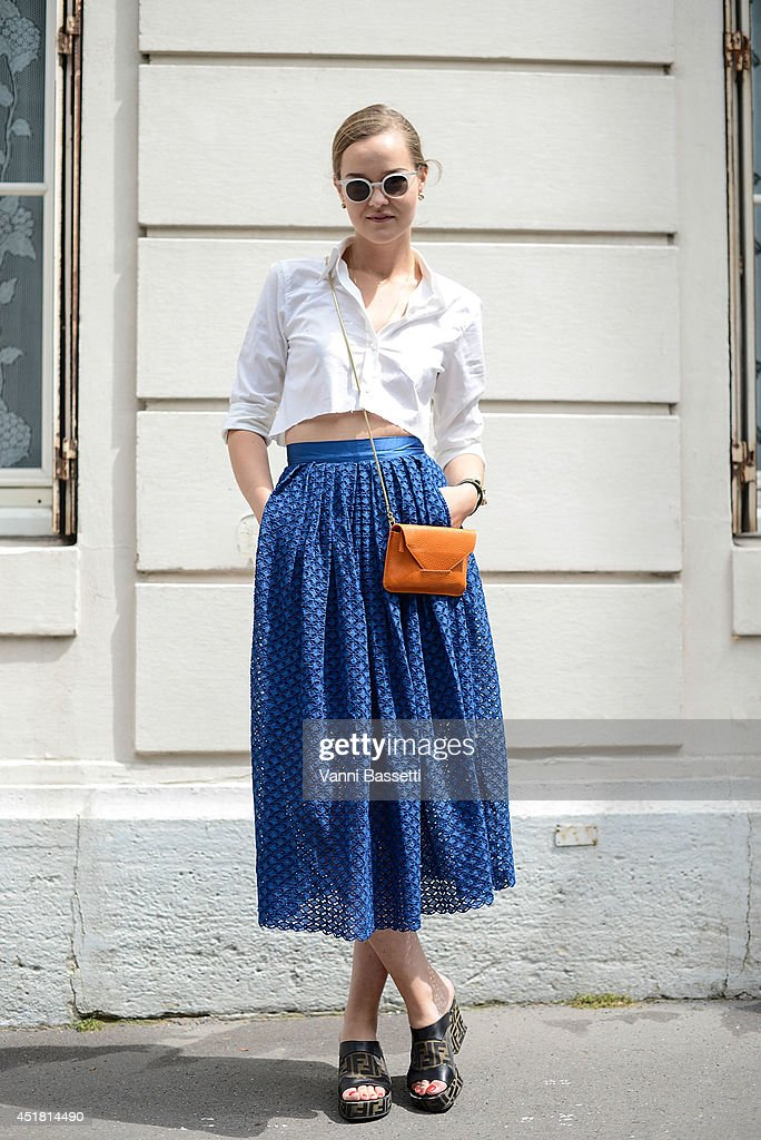 Fashion Blogger Mia Stoelen poses wearing a Filippa K shirt and bag HM skirt Fendi shoes Hermes bracelet and Kaibosh sunglasses before Dior show on...