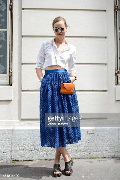 Fashion Blogger Mia Stoelen poses wearing a Filippa K shirt and bag HM skirt Fendi shoes Hermes bracelet and Kaibosh sunglasses before Dior show on...