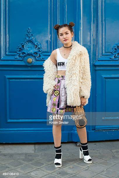Fashion Blogger Miu Pham wears a custom jacket This is not a Love Song top Andre Luciano shorts and a Daisy Street clutch on day 3 during Paris...