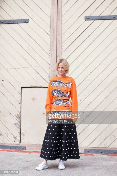 Fashion Blogger Nadia Fairfax is wearing an Alaia skirt Stella McCartney sweater vintage belt and SuperGa shoes during MercedesBenz Fashion Week...