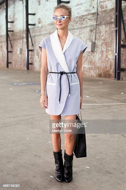 Fashion Blogger Nadia Fairfax wears a Phillip Lim dress Balenciaga bag Givenchy shoes and Le Spec sunglasses at MercedesBenz Fashion Week Australia...