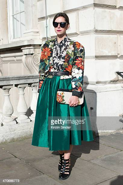 Fashion Blogger Naomi Rowland wears a vintage clutch jacket and top Choies shirt Boohoo shoes Forever 21 sunglasses on day 3 of London Collections...