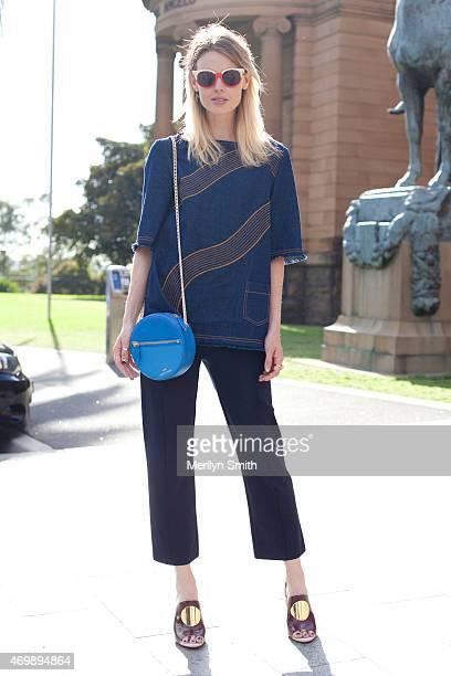 Fashion Blogger Natalie Cantell Karen Walker top Verner trousers Zimmerman shoes Preen sunglasses and Benah for Karen Walker bag at MercedesBenz...