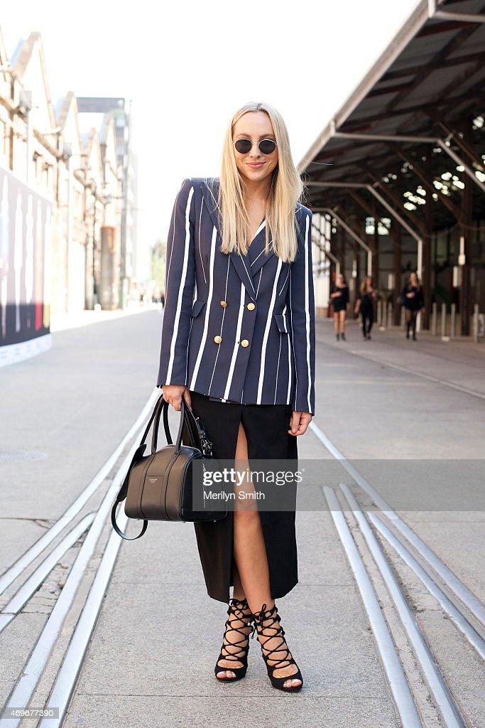 Fashion Blogger Nicole Benton wears a Camilla and Marc blazer Josh Goot skirt and vintage sunglasses and shoes at MercedesBenz Fashion Week Australia...