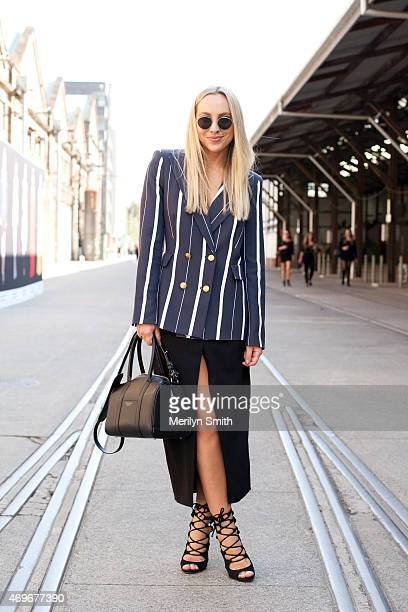 Fashion Blogger Nicole Benton wears a Camilla and Marc blazer Josh Goot skirt and vintage sunglasses and shoes at MercedesBenz Fashion Week Australia...