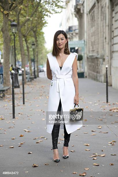Fashion Blogger Nicole Warne wears a Maticevski dress Gianvito Rossi shoes J Brand trousers and a Charlotte Olympia bag on day 6 during Paris Fashion...