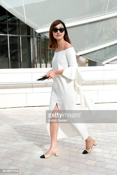 Fashion blogger Nicole Warne wears an Ellery dress and sunglasses and Chanel shoes on day 9 during Paris Fashion Week Spring/Summer 2016/17 on...