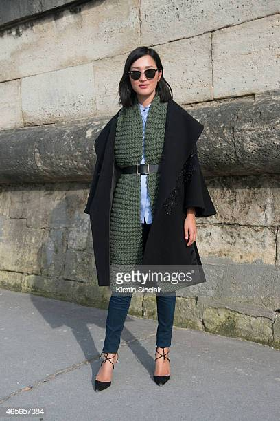 Fashion blogger Nicole Warne wears J Brand jeans Manning Cartell top I Love Mister Mittens scarf Elie Saab jacket Aquazzura shoes and Ray Ban...