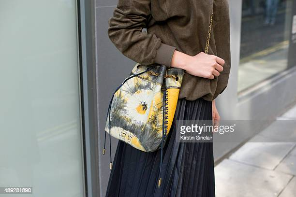 Fashion blogger Nicole Xu wears a Zara skirt top from Korea and Jerome Dreyfuss bag on day 2 during London Fashion Week Spring/Summer 2016/17 on...