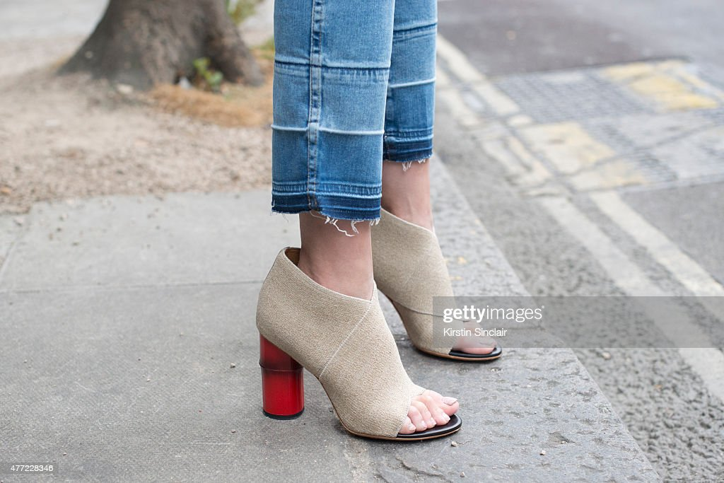 Fashion Blogger Nicole Xu wears Acne jeans and shoes on day 3 of London Collections Men on June 14 2015 in London England