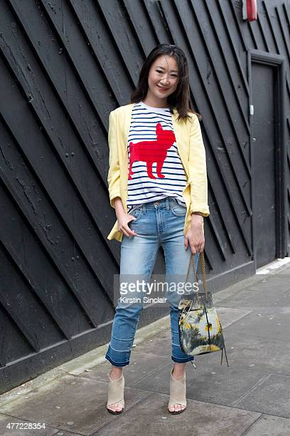 Fashion Blogger Nicole Xu wears Wish jacket Ãtre Cécile T shirt Jerome Dreyfuss Paris bag and Acne jeans and shoes on day 3 of London Collections...