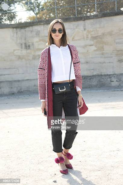 Fashion Blogger Nika Huk wears an Asos top trousers and jacket Yves Saint Laurent bag and vintage sunglasses on day 5 during Paris Fashion Week...