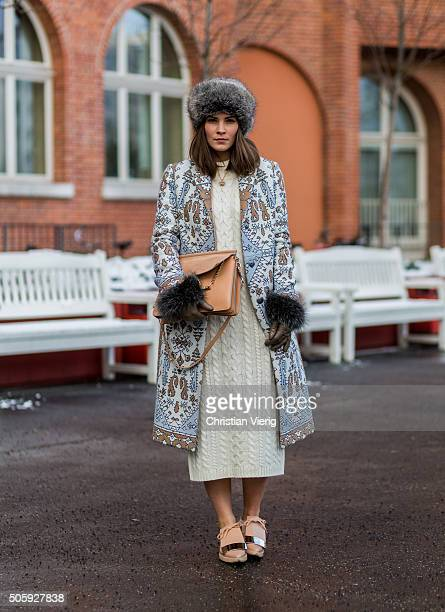 Fashion blogger Nina Schwichtenberg of Fashiioncarpet wearing Tory Burch coat Villa dress Chloe bag Marni shoes Roeckl gloves Zara hat during the...