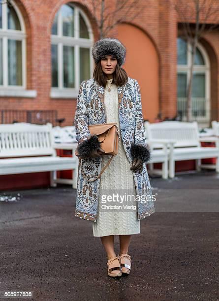 Fashion blogger Nina Schwichtenberg of Fashiioncarpet wearing Tory Burch coat Villa dress Chloe bag Marni shoes Roeckl gloves Zara hat during the...