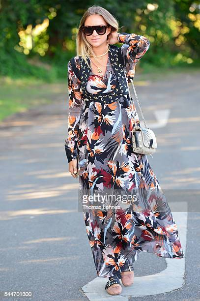 Fashion blogger Nina Suess wearing a dress by Dorothee Schumacher poses during the MercedesBenz Fashion Week Berlin Spring/Summer 2017 on June 29...