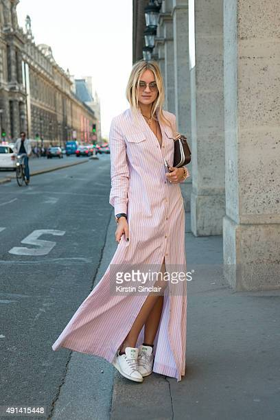 Fashion Blogger Nina Suess wears a Kazs dress Adidas trainers Fendi bag and Miu Miu sunglasses on day 4 of Paris Collections Women on October 2 2015...