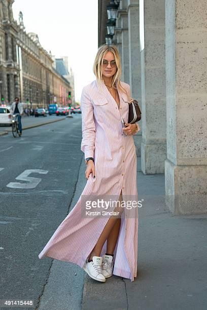 Fashion Blogger Nina Suess wears a Kazs dress Adidas trainers Fendi bag and Miu Miu sunglasses on day 4 of Paris Collections Women on October 2 2015...