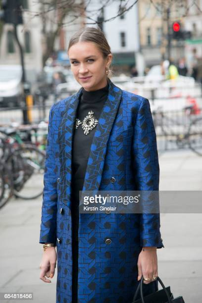 Fashion blogger Nina Suess wears a Temperley coat Antonio Berardi trousers and a Marcus Lupfer shirt on day 5 of London Womens Fashion Week...
