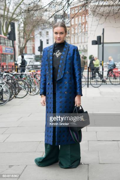 Fashion blogger Nina Suess wears a Temperley coat Antonio Berardi trousers Versace bag and a Marcus Lupfer shirt on day 5 of London Womens Fashion...