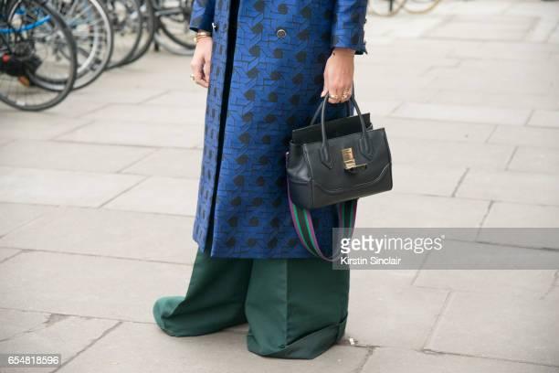 Fashion blogger Nina Suess wears a Temperley coat Antonio Berardi trousers Versace bag on day 5 of London Womens Fashion Week Autumn/Winter 2017 on...