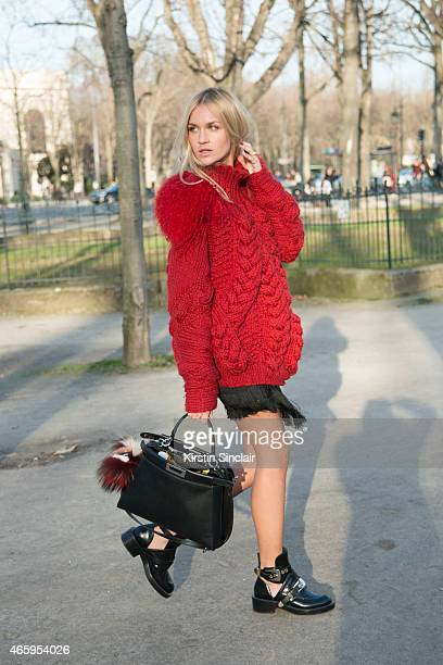 Fashion blogger Nina Suess wears PingHe sweater Balenciaga shoes Fendi bag and Zara skirt on day 6 of Paris Collections Women on March 08 2015 in...