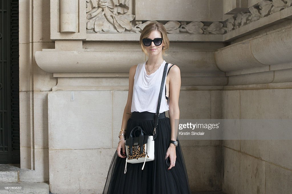 Fashion Blogger of The Blonde Salad Chiara Ferragni wears Alberta Farretti skirt, Phillip Lim bag, American Apparel vest and Thierry Laszry sunglasses on day 5 of Paris Fashion Week Spring/Summer 2014, Paris September 28, 2013 in Paris, France.