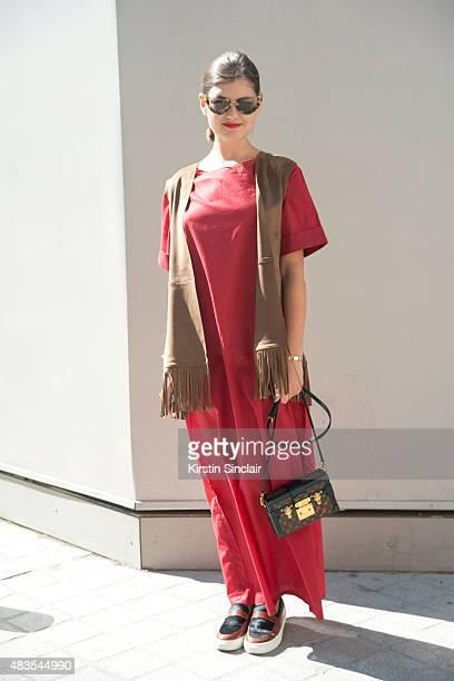 Fashion blogger of The Russian Code Elvira Abasova wears a Natali Leskova dress Louis Vuitton bag Mango waistcoat and Eugene Riconneaus shoes on day...