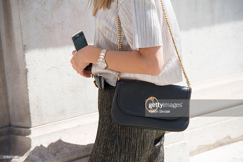 Fashion blogger Oksana Erdogdu wears Gucci belt and bag Bershka top Zara trousers day 4 of Paris Haute Couture Fashion Week Autumn/Winter 2016 on...
