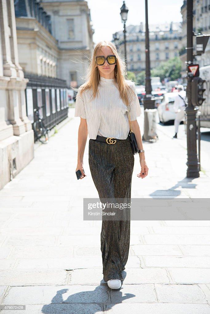 Fashion blogger Oksana Erdogdu wears Gucci sunglasses belt and bag Bershka top Zara trousers and Adidas trainers day 4 of Paris Haute Couture Fashion...