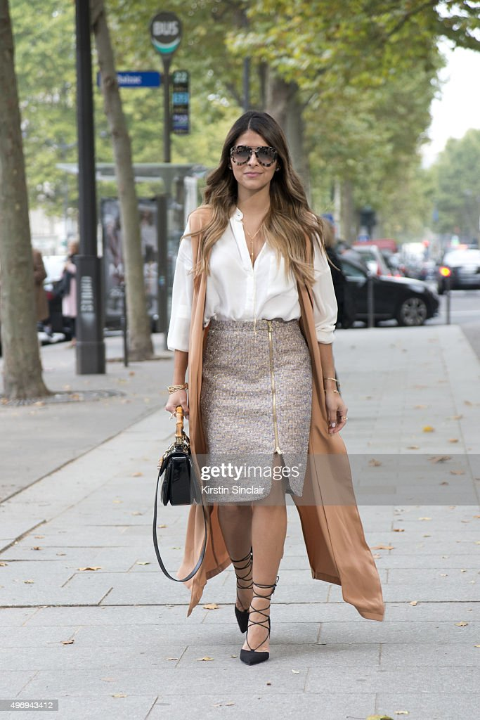 Fashion Blogger Pam Hetlinger wears Asos shoes J Crew skirt The Kayys gillet H and M shirt Gucci bag and Prada sunglasses on day 6 during Paris...