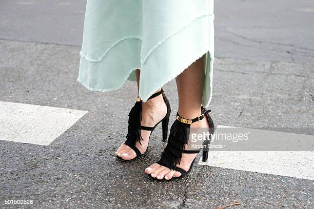 Fashion Blogger Pam Hetlinger wears The Kayys skirt and Chloe shoes on day 8 during Paris Fashion Week Spring/Summer 2016/17 on October 6 2015 in...