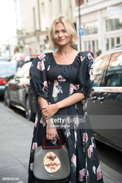 Fashion blogger Pandora Sykes wears a Rejina Pyo dress Mulberry bag and vintage boots on day 2 of London Womens Fashion Week Spring/Summer 2018 on...