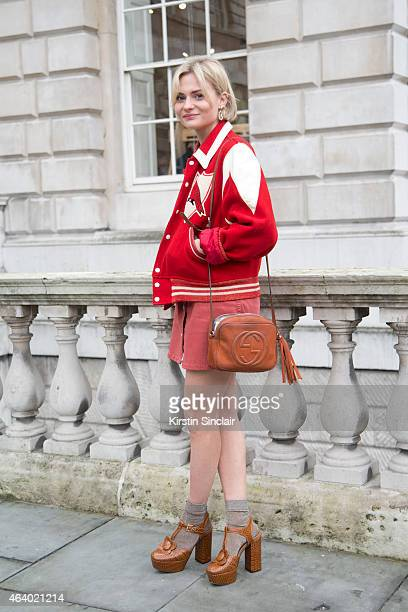 Fashion Blogger Pandora Sykes wears a vintage Varsity jacket Gucci bag AG Alex Chung dress and Orla Kiely shoes on day 1 of London Collections Women...
