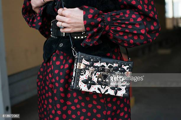 Fashion Blogger Pandora Sykes wears a YSL vintage dress waistcoat and belt vintage and a Louis Vuitton bag on day 2 during Paris Fashion Week...