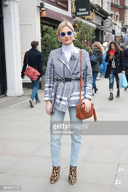 Fashion blogger Pandora Sykes wears Levis jeans a Gucci bag a Cecilie Copenhagan jacket and Free People shoes on February 24 2015 in London England