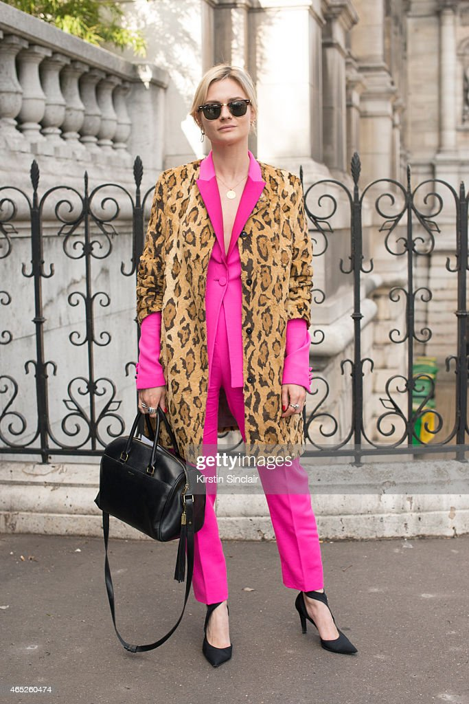 Fashion blogger Pandora Sykes wears Shrimps coat, Pallas jacket and trousers, Balenciaga shoes, Saint Laurent bag and Ray Ban sunglasses on day 2 of Paris Collections: Women on March 04, 2015 in Paris, France.
