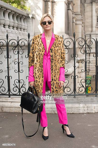 Fashion blogger Pandora Sykes wears Shrimps coat Pallas jacket and trousers Balenciaga shoes Saint Laurent bag and Ray Ban sunglasses on day 2 of...