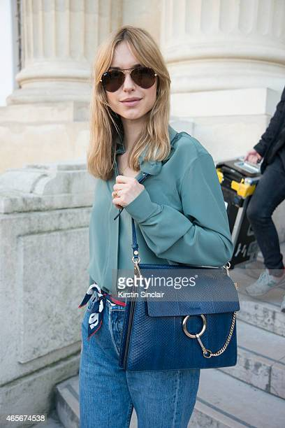 Fashion blogger Pernille Taesbeak wears Ray Ban sunglasses and a Chloe bag at the Chloe show on day 6 of Paris Collections Women on March 08 2015 in...