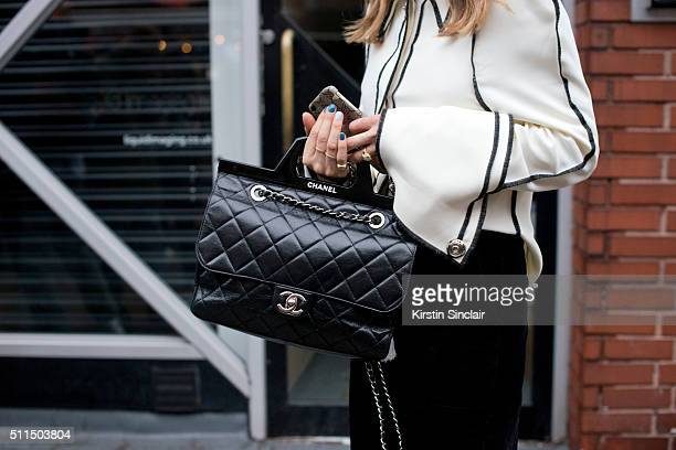 Fashion blogger Pernille Teisbaek wears a JW Anderson shirt and Chanel bag on day 2 during London Fashion Week Autumn/Winter 2016/17 on February 20...