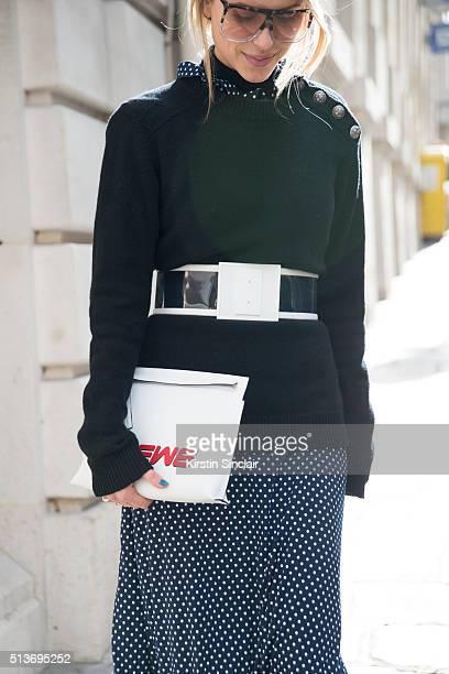 Fashion blogger Pernille Teisbaek wears a Vetements skirt Balmain sweater Loewe bag and sunglasses on day 3 during Paris Fashion Week Autumn/Winter...